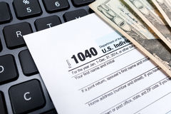 Individual 1040 tax return form on a laptop keyboard Stock Image
