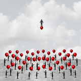 Individual Thinking. Business concept as a group of people on the ground holding balloons with one clever and innovative businessman riding a balloon as an stock illustration