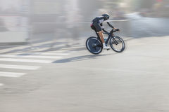 Individual Time Trial Cyclist on the Street Stock Images