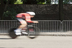 Individual Time Trial Cyclist on a Street. Motion blur royalty free stock images