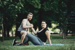 Fitness instructor and client shaking hands royalty free stock images