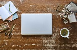 Individual urban office hipster desktop flowers and pictures. Workspace laptop creativity environment royalty free stock image