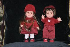 Individual work of the master of porcelain figurines. Two porcelain collection dolls in original red suits. A boy and a girl. 50 th years of the last century Stock Photo