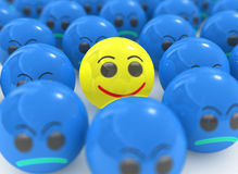 Individual yellow smile. Yellow 3d individual smile among blue balls, out from the crowd Stock Photo