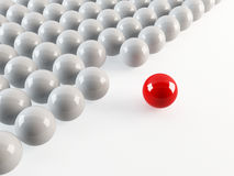 Individualism. 3D rendering of a set of white balls with 1 red out of formation Stock Image
