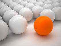 Individuality. 3d illustration; many gray balls and one orange ball Stock Photo