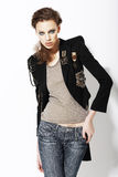 Individuality. Beautiful Eccentric Fashion Model in Jeans Jacket Bijou on Jacket Royalty Free Stock Image
