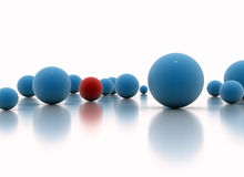 Individuality concept. One red sphere standing out Royalty Free Stock Image