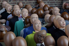 Individuality. A face in the crowd. Group of dolls or dummies, some faceless, representing a crowd of people stock photo