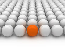 Individuality - gray and orange balls. On white background Royalty Free Stock Photography