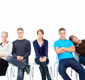 Individuality - Modern students sitting on stools Royalty Free Stock Image