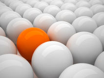 Individuality - orange ball. Individuality - orange and gray balls in 3D illustration Royalty Free Stock Photo
