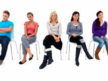 Individuality - People waiting on  stools Royalty Free Stock Image