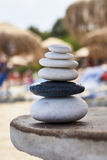 Individuality. Perfectly balanced rocks on a table Stock Photos