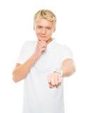 Individuo adolescente que señala en algo en blanco Imagen de archivo libre de regalías