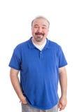 Individuo adulto optimista en la sonrisa azul en la cámara Imagenes de archivo