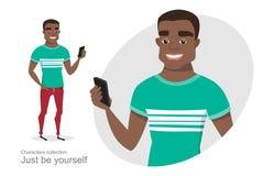 Individuo afroamericano con un teléfono móvil a disposición Imagen de archivo libre de regalías