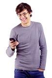 Individuo alegre que goza de su teléfono celular Fotografía de archivo libre de regalías