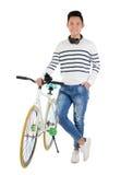 Individuo con la bicicleta Foto de archivo