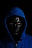 Individuo con la cara pintada negra Foto de archivo libre de regalías