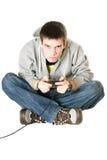 Individuo con una palanca de mando para la consola del juego Fotos de archivo