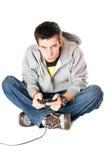 Individuo con una palanca de mando para la videoconsola. Aislado Fotos de archivo libres de regalías