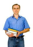 Individuo con una pila de libros. Aislado en blanco. Fotografía de archivo