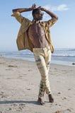 Individuo de la moda en la playa Imagenes de archivo