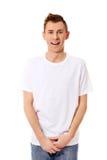 Individuo de la sonrisa de los jóvenes en la camiseta blanca Fotos de archivo