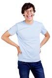 Individuo de risa en vidrios con los brazos en jarras sobre blanco Imagenes de archivo