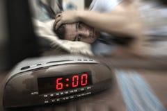 Individuo del reloj de alarma Imagenes de archivo