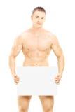 Individuo desnudo que sostiene un panel en blanco Fotografía de archivo