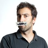 Individuo divertido con el bigote falso Imagen de archivo libre de regalías