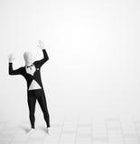 Individuo divertido en el traje del cuerpo del morphsuit que mira el espacio de la copia Imagenes de archivo