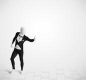 Individuo divertido en el traje del cuerpo del morphsuit que mira el espacio de la copia Imagen de archivo libre de regalías