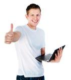Individuo elegante con una computadora portátil fotos de archivo libres de regalías