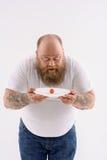 Individuo gordo barbudo chocado de su dieta fotos de archivo libres de regalías