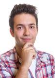 Individuo hispánico sonriente Imagen de archivo libre de regalías