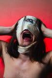 Individuo horrible con la boca asustadiza y un ojo Foto de archivo
