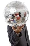 Individuo joven ocultado su cara con la bola del disco Fotografía de archivo