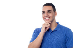 Individuo joven que piensa algo Imagen de archivo