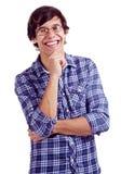 Individuo latino sonriente con la mano en la barbilla Foto de archivo libre de regalías