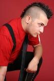 Individuo punky con un cigarrillo Fotografía de archivo