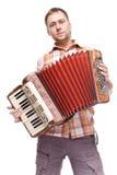 Individuo que juega el acordión Imagen de archivo