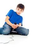 Individuo que juega a los videojuegos Foto de archivo