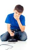Individuo que juega sentarse de los videojuegos Fotografía de archivo