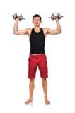 Individuo que lleva a cabo pesas de gimnasia Fotografía de archivo libre de regalías