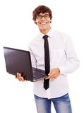 Individuo sonriente con la computadora portátil Imagenes de archivo