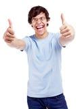 Individuo sonriente que muestra el pulgar para arriba Imágenes de archivo libres de regalías