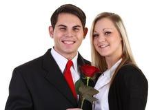 Individuo y muchacha con una rosa Imagen de archivo libre de regalías